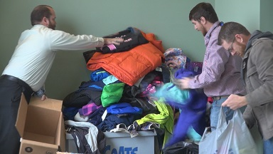 Jared Stanley (WM of Longstreet Lodge in 2014) and Billy Jones (WM of Andrew Chapel Lodge in 2014) and Jason Porter of Longstreet Lodge pile on the coats at the donation bin.