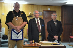 The Grand Master being presented to the Lodge by Past Master Allan Dover along with Treasurer Jason Porter.