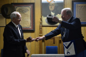 Worshipful Master Danny Fisher passing the gavel to Grand Master Fred Bean.